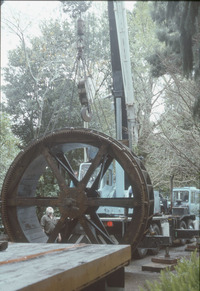 Waterwheel being hoisted out for repair_1.